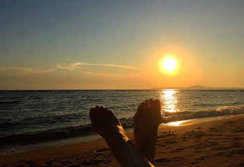 feet and sunset.