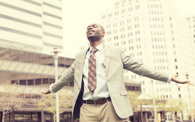 man celebrates freedom success arms raised looking up