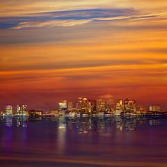 Boston skyline at sunset and river in Massachusetts