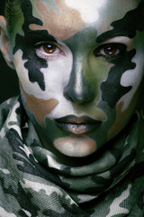 Beautiful young fashion woman with military style clothing and f