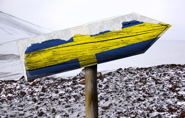 Sweden wooden sign with a snow background
