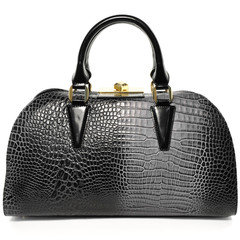 Black and gray woman handbag made of genuine leather isolated on