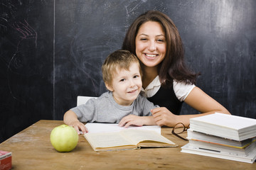 little cute boy with teacher in classroom
