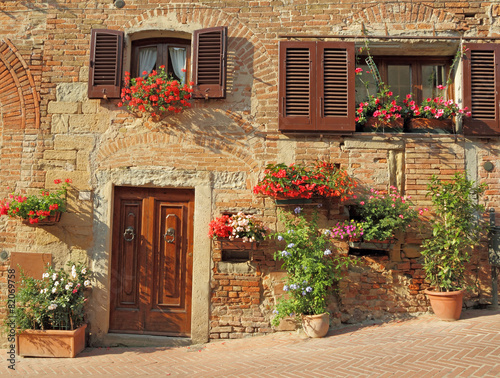 beautiful doorway to the tuscan house decorated  flowers - 82069758