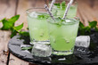 Green cocktail witn rum and mint - 82070330