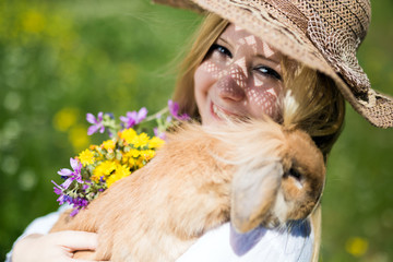 teenager girl with bunny in the nature, very selective focus