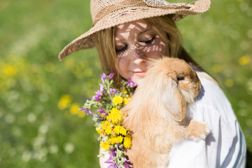 summer girl with bunny, selective focus on the bunny