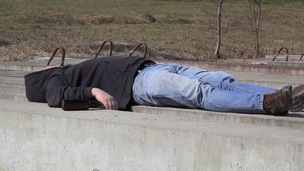 Drunk men sleeping at outdoor