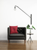 Black leather buttoned couch in a white interior