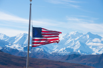 usa flag with mount mckinley in background, denali national park