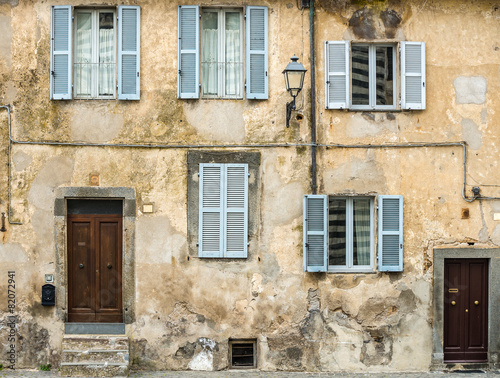 Facade of a home in Tucany, Italy - 82072941