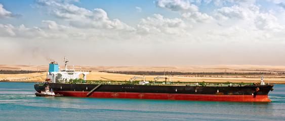 Tugboat assisting supertanker