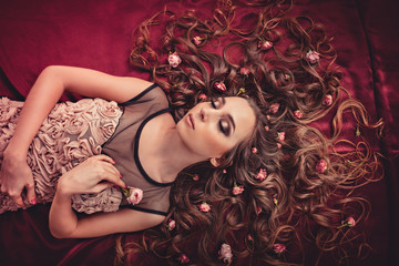 hair with roses expand on the fabric colored Marsala.