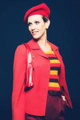 Glamorous woman in a red ensemble