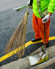 Unidentified street sweeper uses a traditional broom