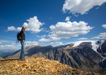 Man in travel standing on mountain top