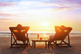 happy couple enjoy luxury sunset on the beach during summer vacations - Fine Art prints