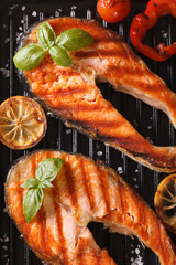 Two grilled steak red fish salmon and vegetables on the grill