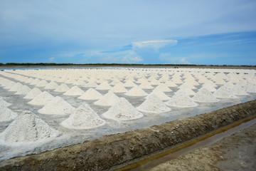 Salt piles in salt farm, Thailand.