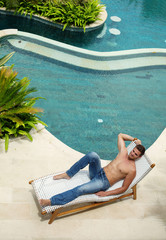 man relaxing near swimming pool