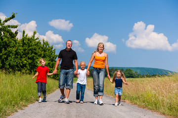 Family walking down that summer path