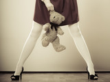 childlike woman with teddy bear toy poster