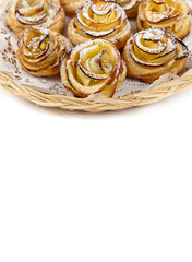 Puff pastry with apple shaped roses on white background