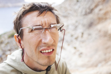 Male climber wearing belay glasses