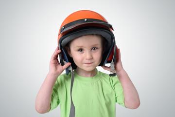 Portrait of a little boy in a motorcycle helmet