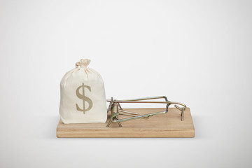 bag with money in wooden mousetrap