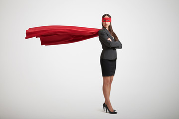 businesswoman dressed as a superhero