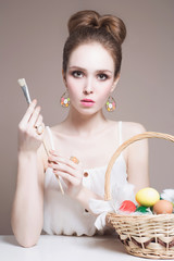 Beauty model girl with colorful eggs