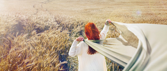 panoramic picture of walking red hair woman by the plain field