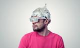 Bearded funny man in a cap of aluminum foil