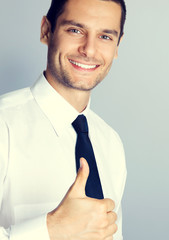 Businessman with thumbs up gesture
