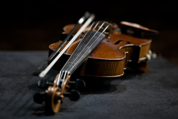 Violin lying in dark colors
