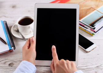 Digital tablet computer with isolated screen in female hands