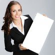 Businesswoman with signboard, on grey