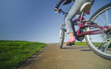 Wide angle view of a child riding a bike