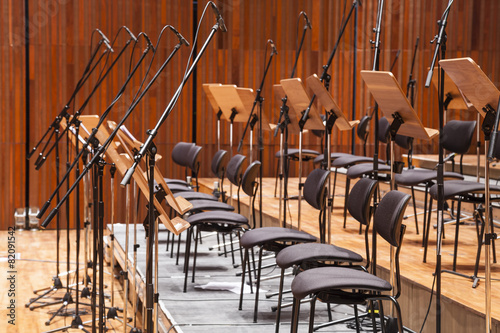 Orchestra stage with chairs and microphone in row - 82091542