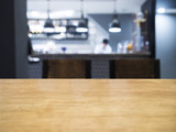 Table top with Blurrd kitchen and chef on background