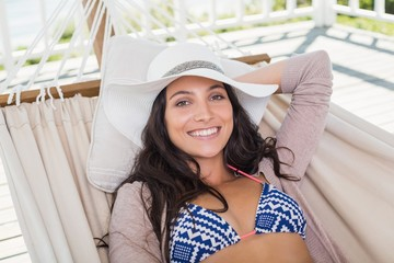 Pretty brunette relaxing on a hammock