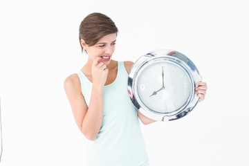 Stressed woman looking at clock