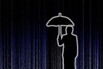 Silhouette of businessman with umbralla in tatrix