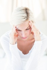 Blonde woman having headache