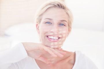 Smiling blonde woman looking at camera