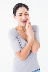 Woman suffering from teeth pain