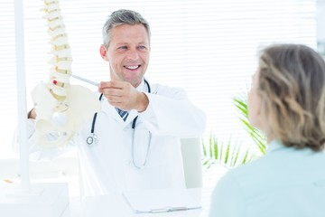 Doctor showing his patient a spine model