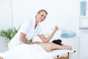 Physiotherapist doing back massage