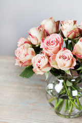 Beautiful cream and pink roses in vase